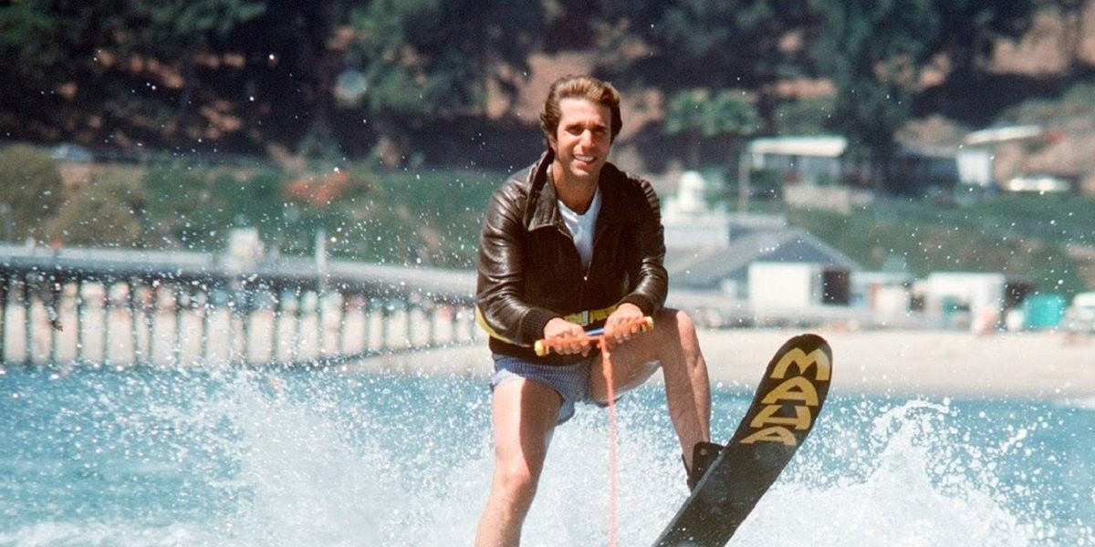 Business man water skiing in leather jacket.